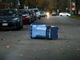 Garbage bins are everywhere but curbside due to strong winds in Rochester Friday morning.