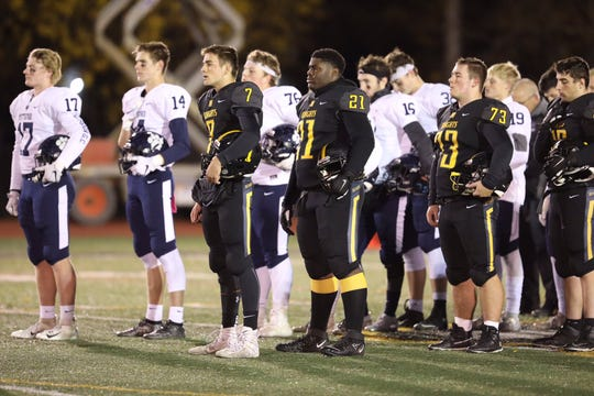 Pittsford and McQuaid players stand for a moment of silence before the Section V Class AA semifinal game on Nov. 1, 2019. Leclair, a 2015 McQuaid graduate, died after a fall from a parking garage in Nebraska this week.