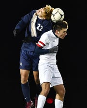 Pittsford Sutherland's Connor Maedl, left, challenges for a header against Wayne's Matt Gentile during the Class A2 sectional final at Hilton High School, Friday, Nov. 1, 2019. No. 1 seed Pittsford Sutherland claimed the A2 title with a 1-0 win over No. 2 seed Wayne.
