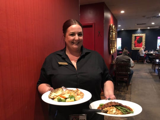 Server Melissa McLaughlin with dinner orders at Karline's Restaurant in downtown Redding.