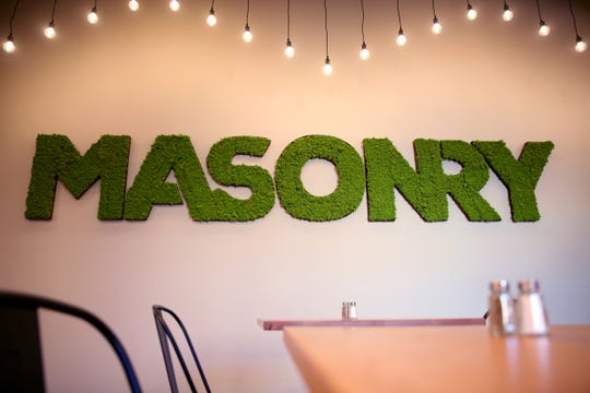 A decorative sign made with moss at Masonry Grill in downtown Salem on Oct. 30, 2019. The restaurant in the former Spaghetti Warehouse building opens Friday.