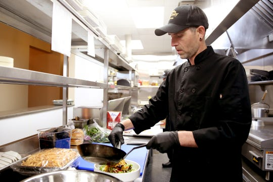 Chef Sam Woodward works at Masonry Grill in downtown Salem on Oct. 30, 2019. The restaurant in the former Spaghetti Warehouse building opens Friday.