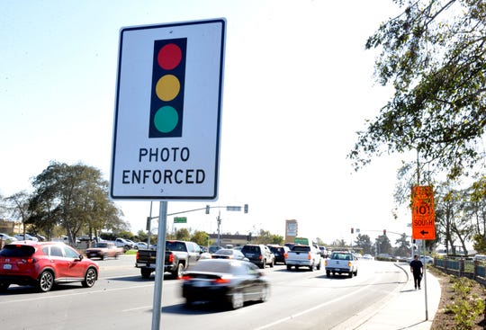 A sign warns drivers that red-light cameras are in place as they approach the intersection of N. Davis Road and W. Laurel Drive Nov. 1, 2019. The cameras came online that day.