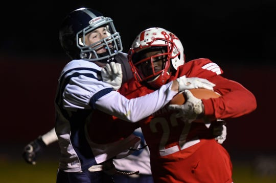 Tyson Mayer from Burke tackles Stanley Haskins Jr. from Britton-Hecla during the class 9A quarterfinals on Thursday, October 31, in Britton.