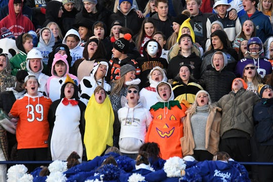 The Sioux Falls O'Gorman student section cheers during the Class 11AAA playoff game against Harrisburg on Halloween night in Sioux Falls.