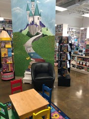 The reading area and mural at Child's Play Toys at Lake Lorraine.