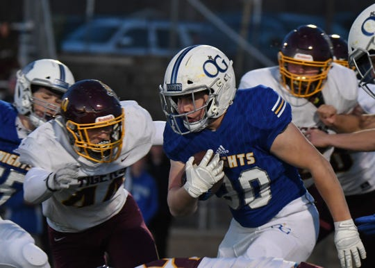 Sioux Falls O'Gorman running back Tate Wishard runs for a first down in the Class AAA playoff game against Harrisburg on Thursday night in Sioux Falls.