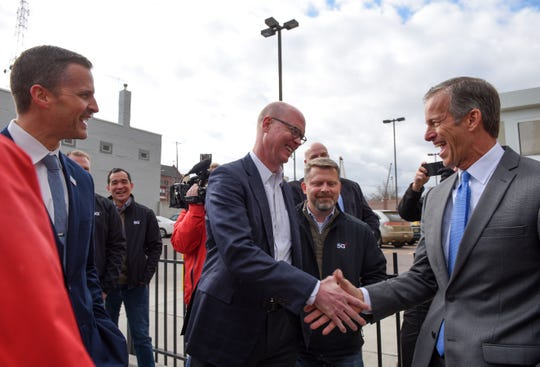 Senator John Thune and Verizon representative Craig Silliman shake hands in celebration of the 5G launch in Sioux Falls on Friday, November 1.