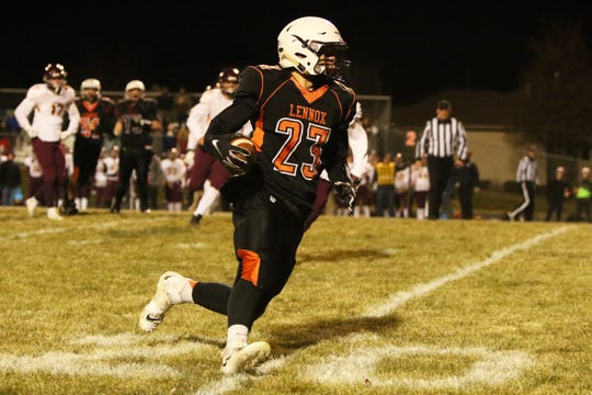 Will Daugherty of Lennox runs the ball after a reception during Thursday night's playoff game against Madison in Lennox.