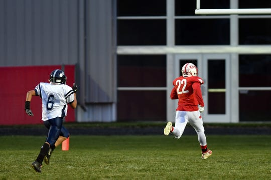 Stanley Haskins Jr. from Britton-Hecla runs the ball down the field for a touchdown, trailed by Ethan DeLong from Burke during the class 9A quarterfinals on Thursday, October 31, in Britton.