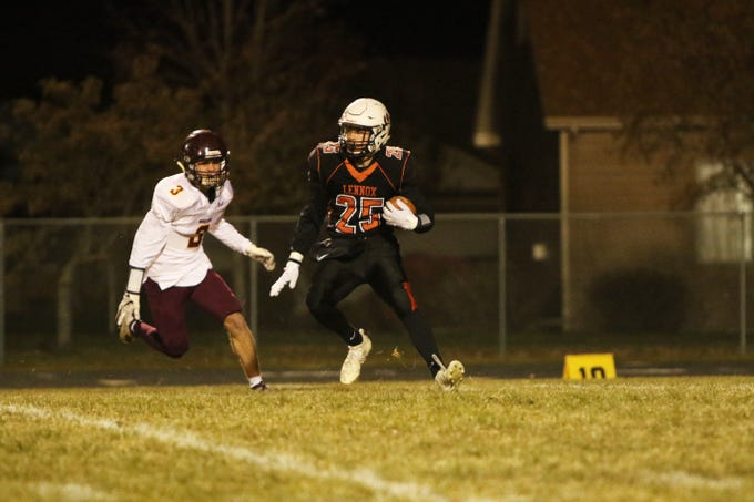 Caleb Metcalf of Lennox runs the opening kickoff as Brock Minnaert of Madison pursues during Thursday night's playoff game in Lennox.