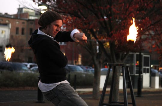 Dylan Jacobs of Scintillation Fire Troupe performs during the 2012 Sparkles and Sweets event.