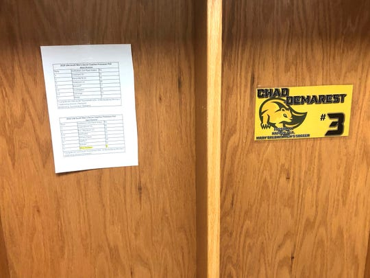 Chad Demarest's locker, complete with the preseason poll that all his teammates have in their lockers also. The team used the last-place prediction as motivation.