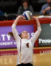 Emily Balts sets the ball for UMD Thursday, Oct. 31, 2019, at Halenbeck Hall.