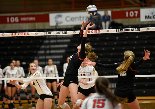 Maddy Torve sets the ball as her sister looks on Thursday, Oct. 31, 2019, at Halenbeck Hall.
