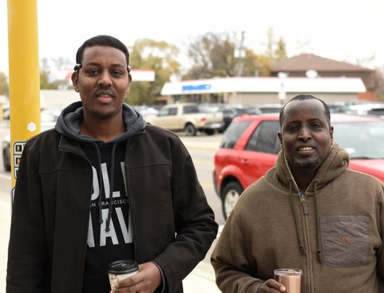 Mohamad Abdulle and Mahad Ahmed smile before their final day at Electrolux Friday, Nov. 1, 2019.