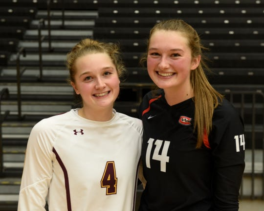 Sisters Emily (Torve) Balts and Maddy Torve smile for a picture after a four-set win for SCSU Thursday, Oct. 31, 2019, at Halenbeck Hall.