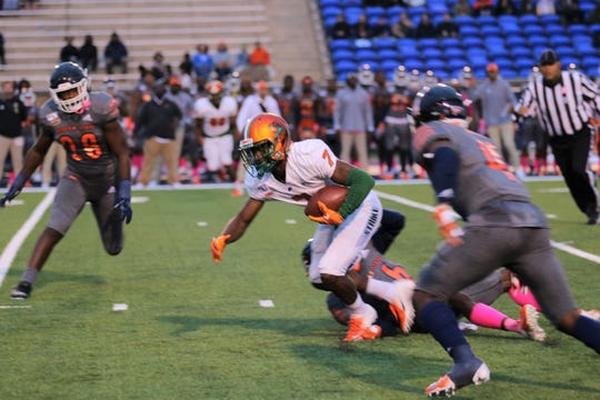 FAMU wide receiver George Webb breaks free from a tackle against Morgan State.