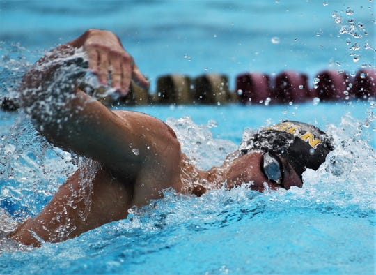 Lincoln senior Josh Lamar swims freestyle at the District 2-3A meet at Morcom Aquatics Center on Tuesday, Oct. 29, 2019.
