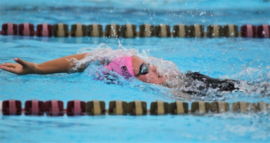 Chiles freshman Carly White swims backstroke during the 200 IM at the District 2-3A meet at Morcom Aquatics Center on Tuesday, Oct. 29, 2019.