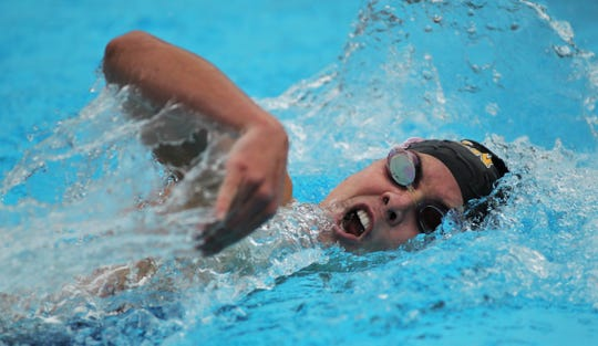 Lincoln senior Saige Kemeny swims freestyle during the 200 IM at the District 2-3A meet at Morcom Aquatics Center on Tuesday, Oct. 29, 2019.