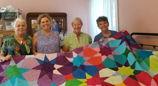Grateful Threads quilts Carol Hyden, Julie Steward, Kathy Heinz and Janice McLain.