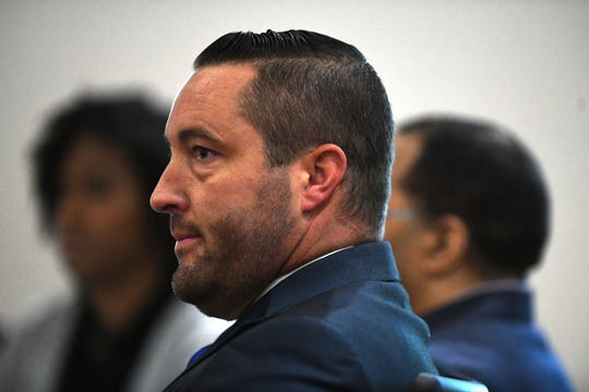 Henry Segura's defense attorney Nate Prince listens as Assistant State Attorney Jon Fuchs addresses the courtroom on Friday, Nov. 1, 2019. Segura is charged with the 2010 murder of his then-girlfriend, her twin daughters, and their 3-year-old son.
