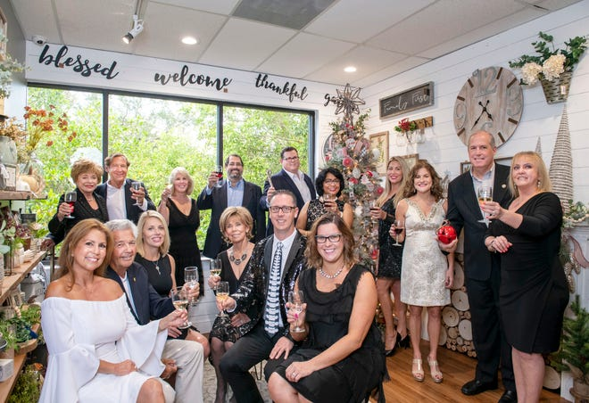 The 2019 Festival of Trees & Lights Dames & Deers raise a toast to Tykes & Teens during a special reception at Kling Gallery Wine & Décor. Back row, from left, Judie Price, Tom Whittington, Jan Chase, Ted Astolfi, George Stokus, Arati Hammond, Sarah Andersen, Joanne Zarro, Ed Ciampi and Candace Lopes; front row, Maria Reich, Butch Bayley, Kelly Johnson, Pat Brimlow, Brian Moriarty and Amy Thornton. Not pictured: Joe Connelly, John Fedorek and Ben Masondo.