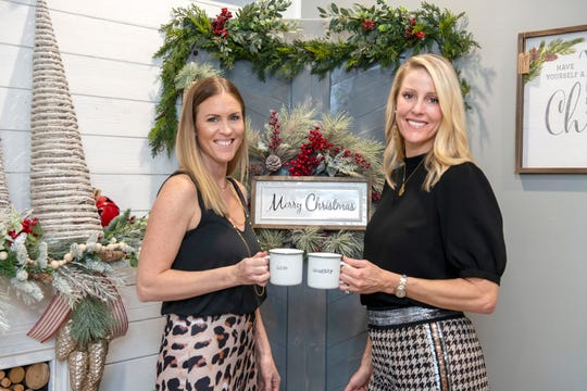 Amanda Kling, left, of Kling Gallery Wine and Décor and Michelle Hill, representing Searcy, Denney, Scarola, Barnhart & Shipley, Attorneys at Law, toast to a successful 2019 Festival of Trees & Lights.