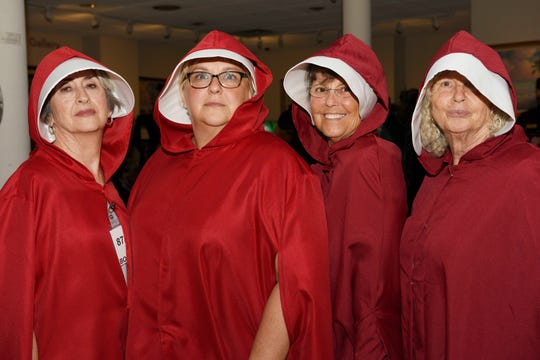 Becky Sims, left, Kathleen Fredrick, Julie Lounibos and Shelly Polvere as Handmaids, winners of the Best Group Award, at the Backus Boo Ball on Oct. 26, 2019 in downtown Fort Pierce.