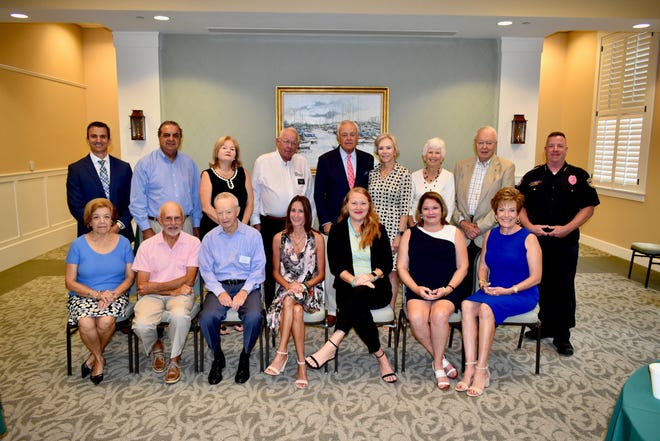 National Philanthropy Day honorees, from left, front row, Henriette Churney, Dick Gates, Bruce McEvoy, Wendy Person, Cynthia Pilloni, Colleen Bonner and Eileen Furino; back row, Ryan Cobb, Chef Joe Faria, Bernadette Emerick, Bradley Lorimier, Michael Smith, Sassy Smith, Jean Cravens, Gene Cravens and Chief Rich Rosell.