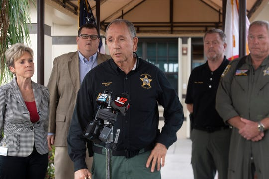 Martin County Sheriff William Snyder (center) spoke at a news conference Nov. 1, 2019, following the death of a pilot in a single-plane crash at Witham Field in Stuart on the first day of the Stuart Air Show.