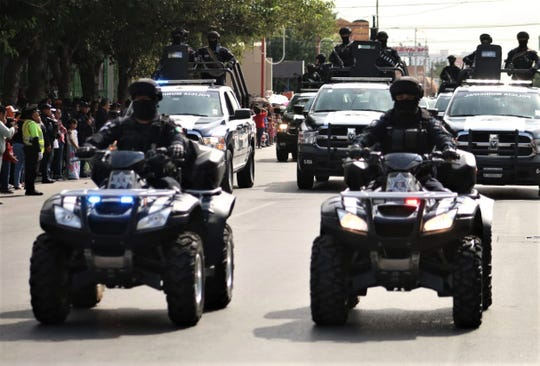 Juarez police take part in the 2019 Mexican Independence Day parade in Juarez, Mexico.