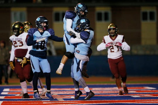 Chapin's Demian Rodriguez scores a touchdown against El Dorado during the game Thursday, Oct. 31, at Irvin High School in El Paso.