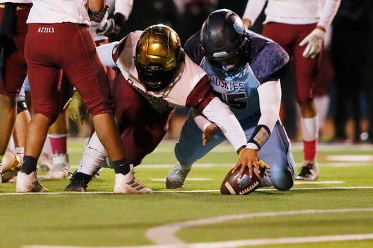 El Dorado's Isaiah Rudison and Chapin's Demian Rodriguez attempt to gain control of the ball during the game Thursday, Oct. 31, at Irvin High School in El Paso.