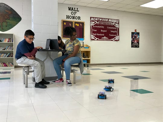 Montwood Middle School students control robotic cars during a Fab Lab El Paso Mobile STEM Lab visit to the school Nov. 1, 2019.