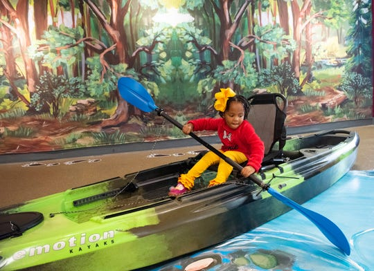 Charli Rosemond, 4, plays in a kayak in the new outdoor exhibit at The Children's Museum of the Upstate in Greenville.