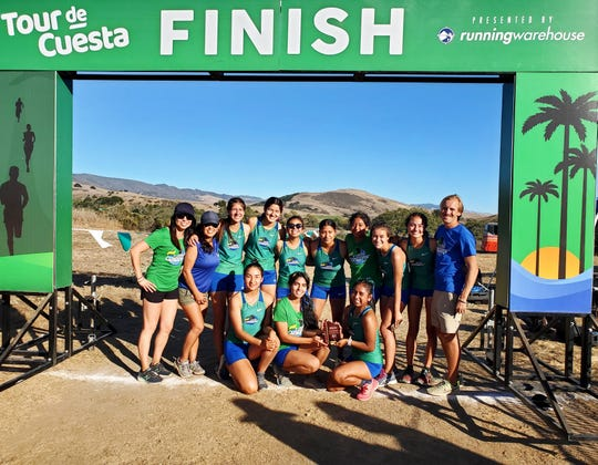 Members of the Oxnard College men's women's cross country team celebrate finishing second at the WSC Championships for the first time in school history in San Luis Obispo on Oct. 25.