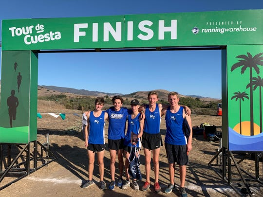 Members of the Moorpark College men's cross country team celebrate finishing second at the WSC Championships in San Luis Obispo on Oct. 25.