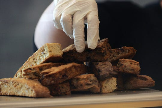 "Robyn Lee arranges several flavors of mandel bread on a plate at Historia Bakery, the Thousand Oaks business she opened in October with brother and chef Keven ""Cheven"" Lee."