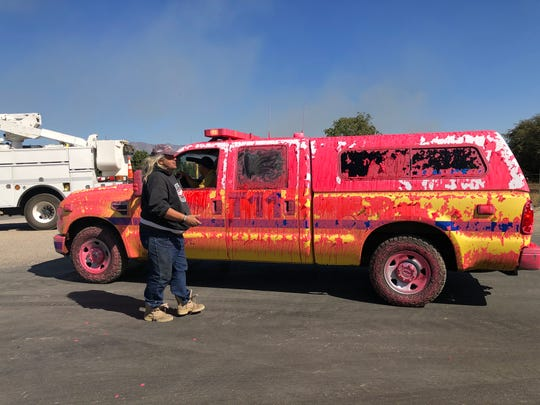 Fire retardant covers this vehicle on Friday as crews battle the flames of the Maria Fire, which erupted on South Mountain between Santa Paula and Somis.