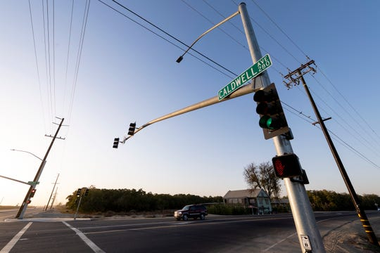 Motorists pass along Caldwell Avenue between Akers and Highway 99 on Wednesday, October 30, 2019. Traffic lights, more lanes and a median have been added since Tulare County voters passed Measure R 13 years ago.