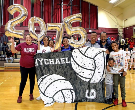 Ossining head coach Lauren Riccardi and the family of Mychael Vernon (6) help her celebrating her 2075 kills during Section 1 Class AA volleyball quarterfinals against Ursuline at Ossining High School on Nov. 1, 2019.