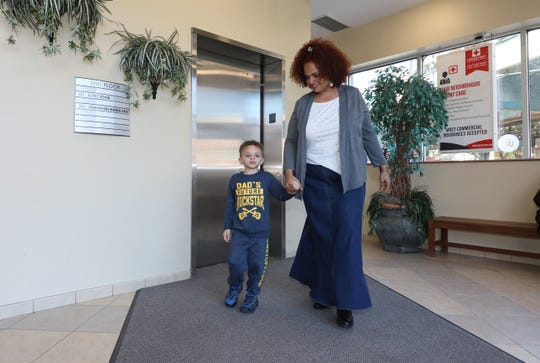 Jocelyn David-Burch walks with her special needs son, David, 4, at the SteppingStone Day School, Inc. in the Bronx, Nov. 1, 2019.