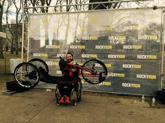 Peter Gagliardo holds his handcycle at Philadelphia's Rocky Run Half Marathon.