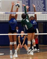 From left, Hendrick Hudson's Caitlin Weimar (12) blocks a shot from Yorktown's Allison Torres (6) during the Class A volleyball semifinal at Hendrick Hudson High School in Montrose Oct. 31, 2019. Hen Hud won 3-0.
