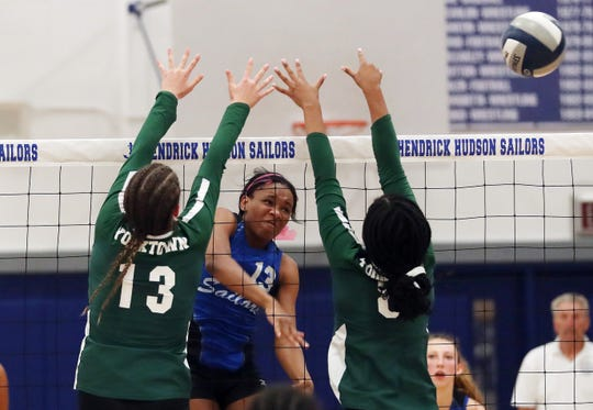 Hendrick Hudson's Ashanti Davis (13) returns a shot against Yorktown during the Class A volleyball semifinal at Hendrick Hudson High School in Montrose Oct. 31, 2019. Hen Hud won 3-0.