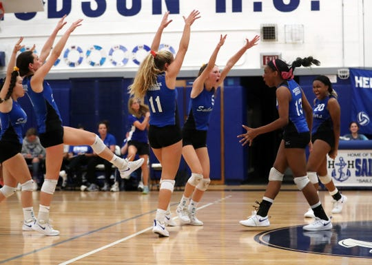 Hendrick Hudson players celebrate a point against Yorktown during the Class A volleyball semifinal at Hendrick Hudson High School in Montrose Oct. 31, 2019. Hen Hud won 3-0.