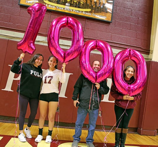 Ossining's Briana Culcay (17) celebrates her 1,000 assists with her family after playing during Section 1 Class AA volleyball quarterfinals against Ursuline at Ossining High School on Nov. 1, 2019.