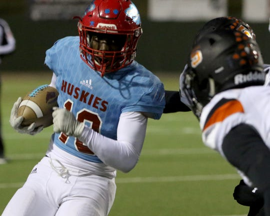 Hirschi's KD Dorsey is stopped by Springtown defenders Thursday, Oct. 31, 2019, at Memorial Stadium.